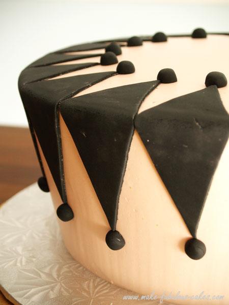design on side of masquerade cake