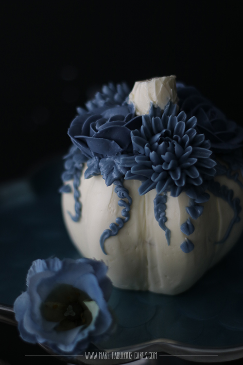 White pumpkin cake with blue flowers