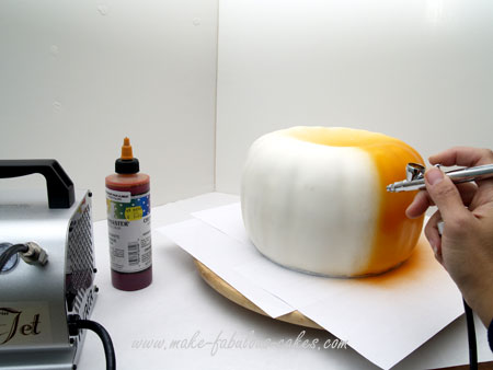 airbrushing pumpkin cake