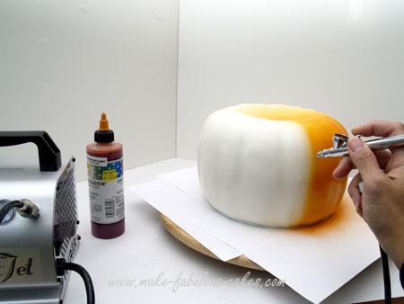 airbrushing pumpkin cake